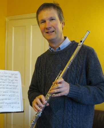 A flute teacher with his flute and music